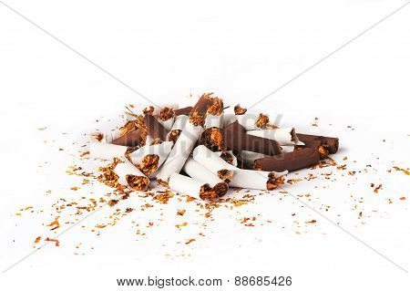 Pile Of White And Brown Broken Cigarettes