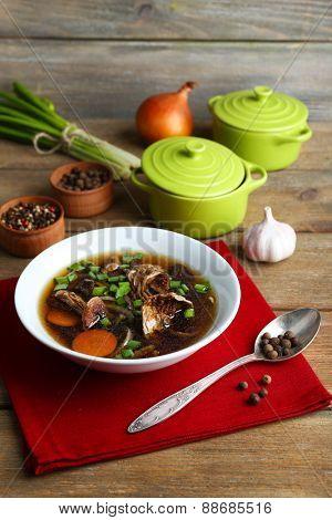 Mushroom soup on wooden background
