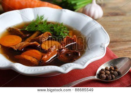 Mushroom soup on color napkin, closeup