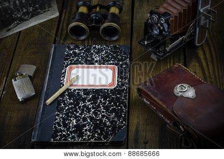 Vintage war correspondent reporter diary with binocular, camera, leather holster, lighter, vintage p