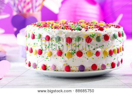 Birthday cake on colorful background