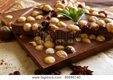 Delicious chocolates with spices on table, closeup