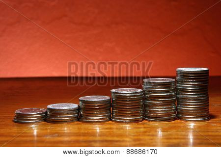 Pile of coins in ascending form