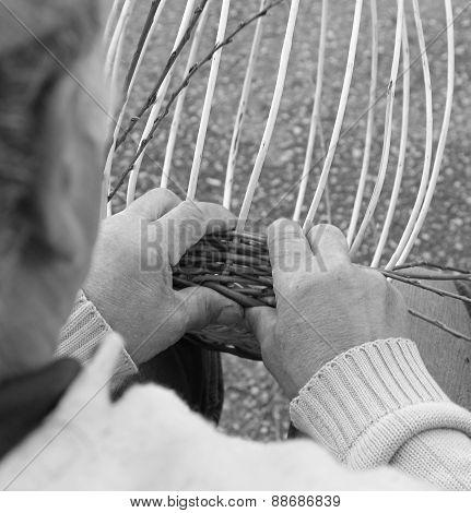 Senior Expert Craftsman Creates A Wicker Basket