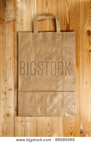 Paper bag on a wooden texture