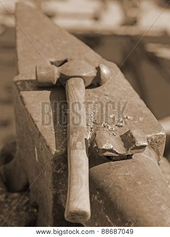 Heavy  Anvil And Sturdy Hammer In The Blacksmith's Shop