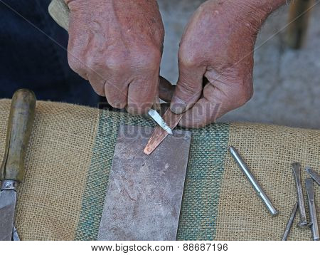 Hands During The Processing Of A Copper Tool