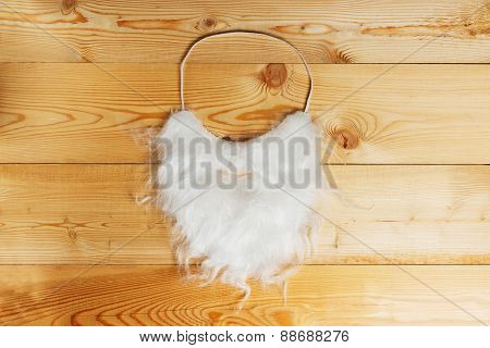 White beard on a wood