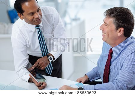 Managers with digital tablet