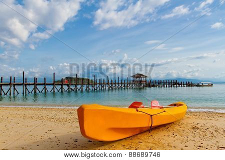 Yellow kayak on beach