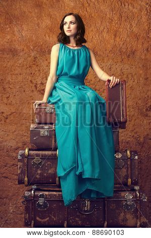 Fashion woman with suitcases
