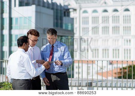 Group of businessmen with digital tablet