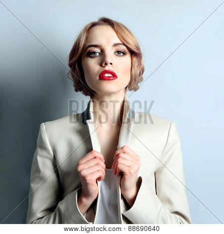 Portrait of expressive young model on light blue background