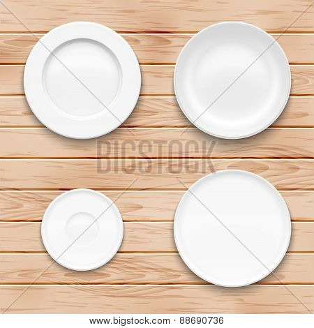 White plate set on wooden background. Kitchen dishware.