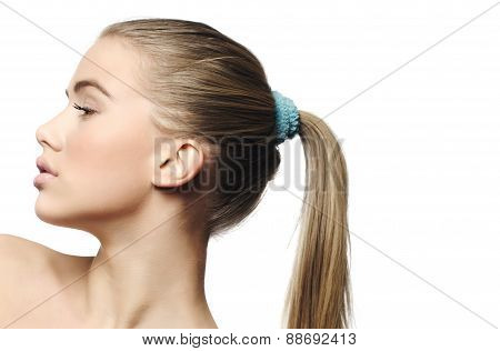 Beauty girl face with ponytail, blue ribbon,isolated on white