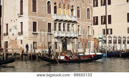 Tourists Travel On Gondolas At Canal In Venice, Italy