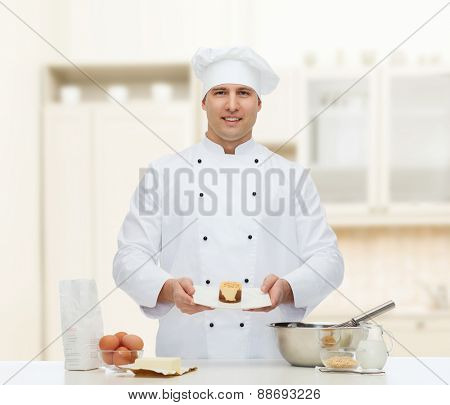 cooking, profession, haute cuisine, food and people concept - happy male chef cook baking dessert over kitchen background