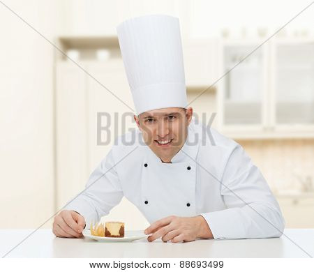 cooking, profession, haute cuisine, food and people concept - happy male chef cook with dessert over kitchen background