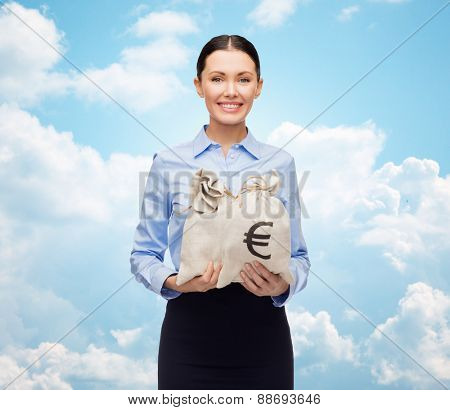 business, people, finances, investments and banking concept - young businesswoman holding money bags with euro over blue sky and clouds background