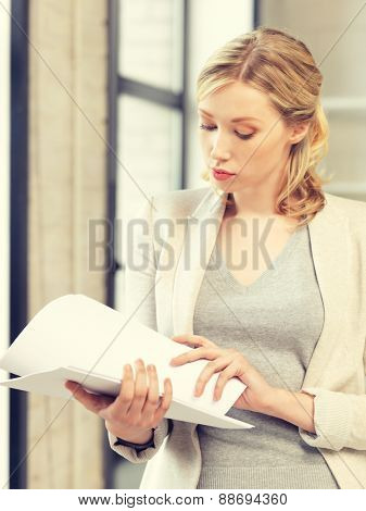 indoor picture of calm woman with documents