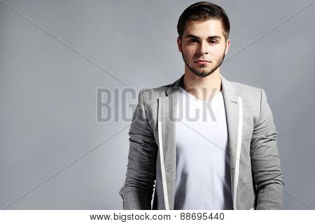 Young man on gray background