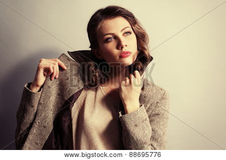 Portrait of expressive young model on wall background