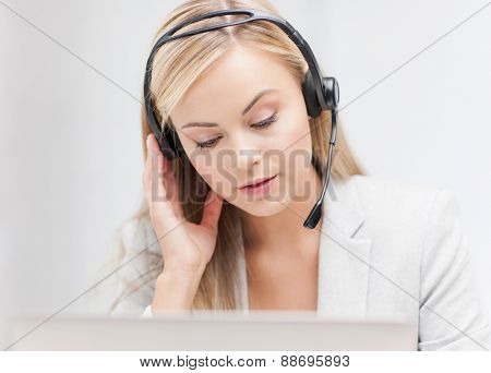 female helpline operator with headphones and laptop