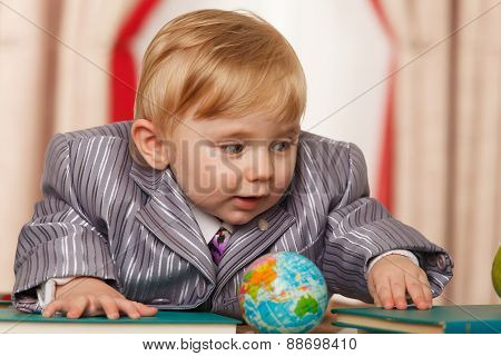 Baby Boy With Small Globe And Books
