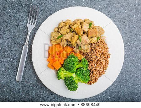 Buckwheat With Meat And Vegetables Ona White Plate