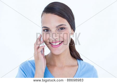 Happy woman on the phone on white background
