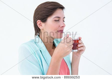 Peaceful woman drinking cup of tea on white background