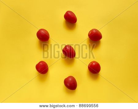 Tomatoes On Yellow Background