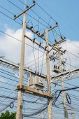 foto of voltage  - Electric transformer on the pole Transform Electric high voltage to low voltage - JPG