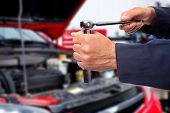 image of auto garage  - Hand of car mechanic with wrench - JPG