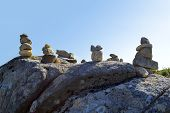 Stones balancing on top of Foia the highest mountain of Algarve, Portugal. poster