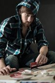stock photo of addict  - Addicted man preparing a line of cocaine - JPG