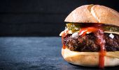 foto of beef-burger  - Juicy beef burger with cheese and onionselective focus and blank space - JPG