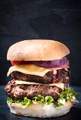 image of beef-burger  - Double beef burger with cheese and vegetablesblank space and selective focus - JPG