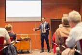 stock photo of entrepreneurship  - Speaker Giving a Talk at Business Meeting. Audience in the conference hall. Business and Entrepreneurship. Copy space on white board.