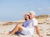 picture of couple sitting beach  - Couple sitting on the beach - JPG