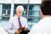 stock photo of interview  - Two businessmen during interview in office - JPG