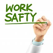 foto of workplace safety  - doctor writing work safety words in the air - JPG