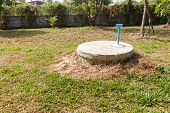 picture of septic  - underground cement cylinder of lavatory cesspit in lawn yard - JPG