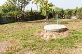 pic of septic  - underground cement cylinder of lavatory cesspit in lawn yard - JPG