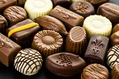 stock photo of truffle  - Delicious chocolate truffles and candy on a dark background - JPG
