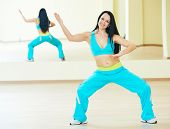 pic of zumba  - zumba firness instructor doing dancing exercises in sport club - JPG
