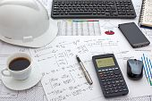 stock photo of structural engineering  - Desk of Civil Design Engineer who has just made structural analysis calculations using a scientific calculator - JPG