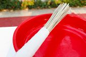 foto of blessed  - bundle of wooden stick on red tray for buddhism monk to bless people - JPG