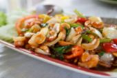 picture of fried onion  - blurry defocused image of fried chicken stir fry with cashew nut sweet pepper onion for background - JPG