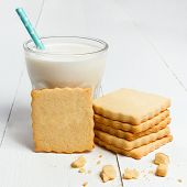 stock photo of milk glass  - Glass of milk and biscuits on white wooden background - JPG